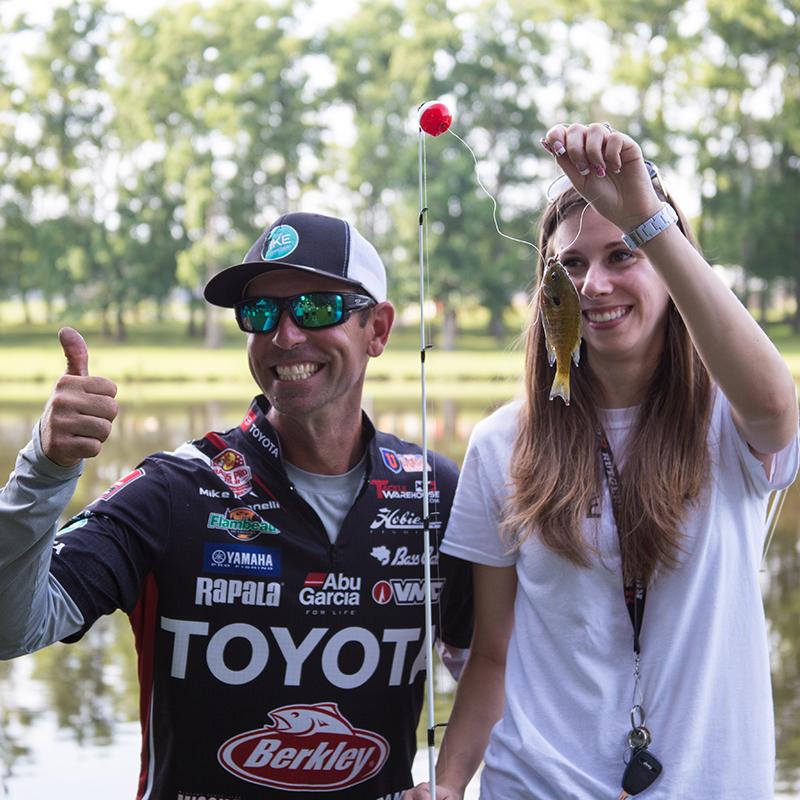 Ike Foundation   Ike and girl holding fish